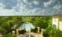 The formal pool of The Omni Orlando Resort at ChampionsGate overlooking the course.