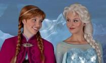 Frozen's Anna and Elsa wait to greet fans at Walt Disney World in Orlando, Florida.