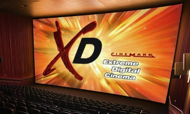 Watch a 3D movie in comfortable stadium seating.