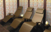 Pure Salt Room at Gentle Touch features Himalayan salt bricks and zero-gravity Perfect Chairs.